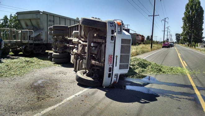 A truck hauling green beans overturned Friday and blocked traffic on River Road NE.