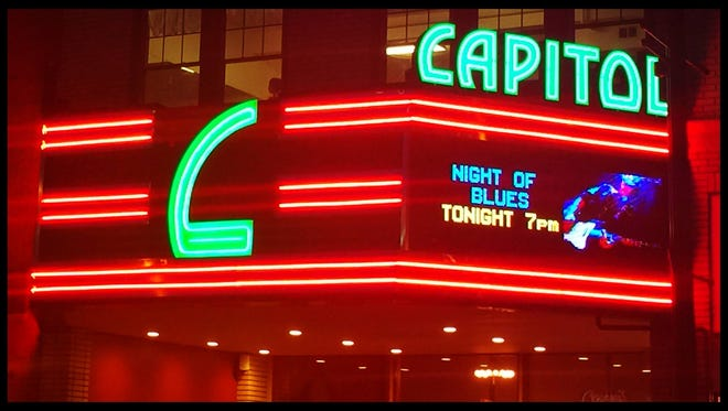 The Capitol Theatre marquee at night.