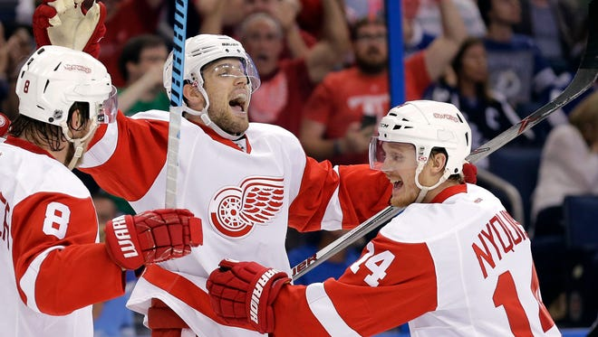Detroit Red Wings center Riley Sheahan celebrates his goal against the Tampa Bay Lightning with Gustav Nyquist, right.