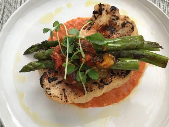 The seared cauliflower steak ($16) in Romaneso sauce,