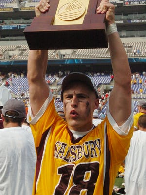 Salisbury University's Kyle Hartzell, holds the trophy as the rest of the team celebrates after winning the NCAA Men's Division III Lacrosse title Sunday at M&T Bank stadium in Baltimore. Salisbury won the NCAA Division III national championship Sunday, May 27, 2007 over Cortland University 15 to 9.(AP photo by Todd Dudek)