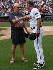 WW II veteran Charlie Tozier, left, greets Minnesota Twins Manager Paul Molitor Tuesday at  Hammond Stadium.