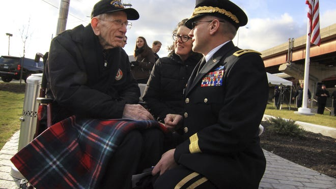 U.S. Navy veteran Floyd Welch, left, speaks to Connecticut National Guard Maj. Gen, Fran Evon as they attend the Pearl Harbor Memorial Park Dedication Ceremony on Dec. 6, 2018, in New Haven, Conn.  Welch, one of the last survivors of the battle of Pearl Harbor, died at his home in East Lyme, Conn., on Monday, Aug. 17, 2020. He was 99. Welch was serving aboard the USS Maryland on Dec. 7, 1941, when the U.S. fleet came under attack by Japan.
