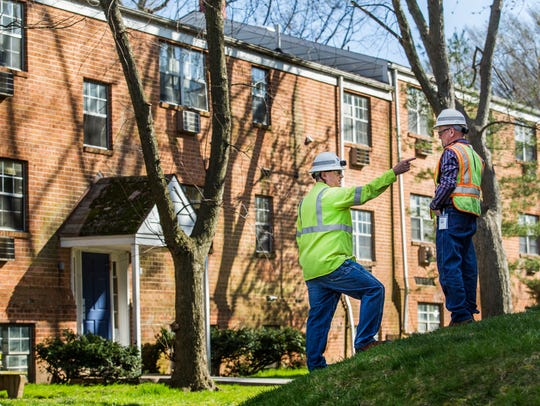 Delmarva Power workers at Evergreen Apartments at Riverfront Heights.