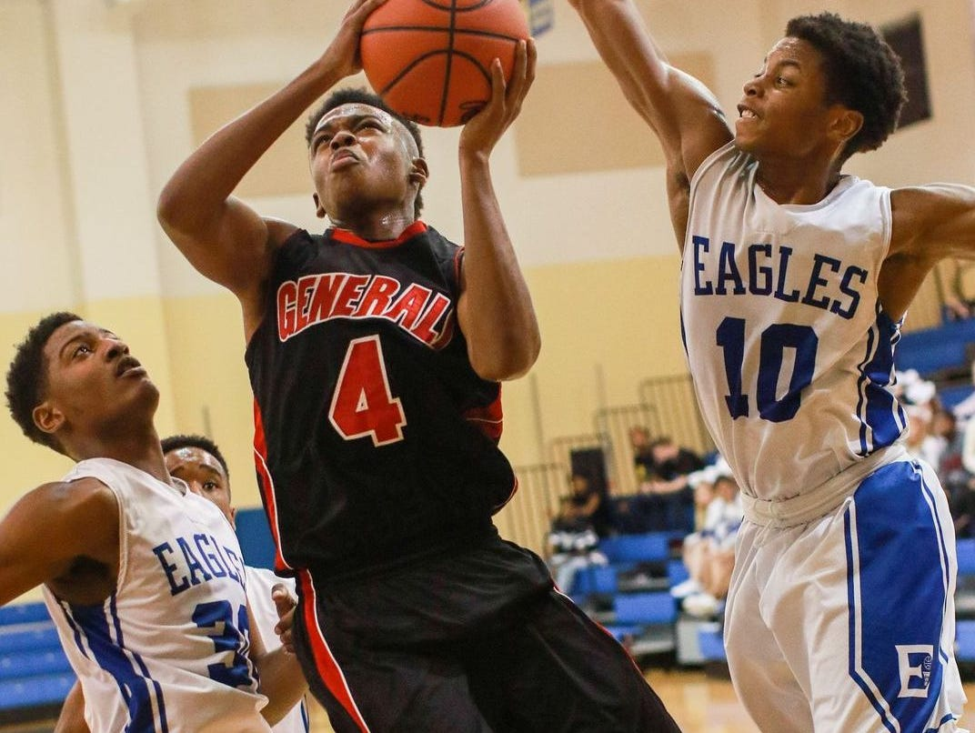 Wade Hampton's Preston Parks (4) goes up for two between Eastside's Rico Williams, left, and Ray Wilson during the Generals' 70-55 victory Thursday night at Eastside.
