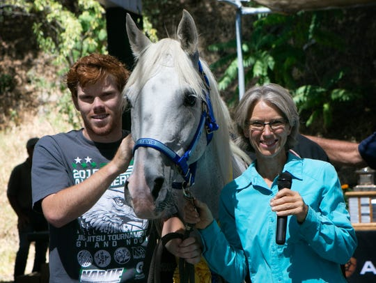 Karen Donley, winner of the 2016 Tevis Cup, poses with