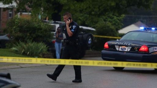 Police investigate a shooting in Springfield Township Friday evening.