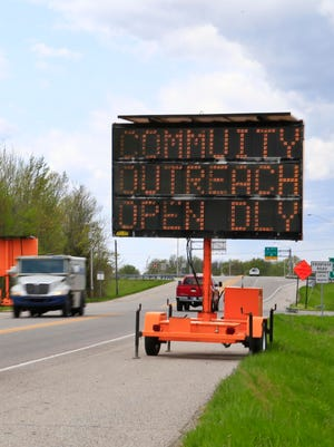 A highway sign notifies motorists of the Austin Community Outreach Center's hours on Highway 256 in Austin, Ind., Tuesday afternoon. Indiana Gov. Mike Pence declared the Scott County HIV outbreak a public health emergency and authorized a short-term needle exchange program.