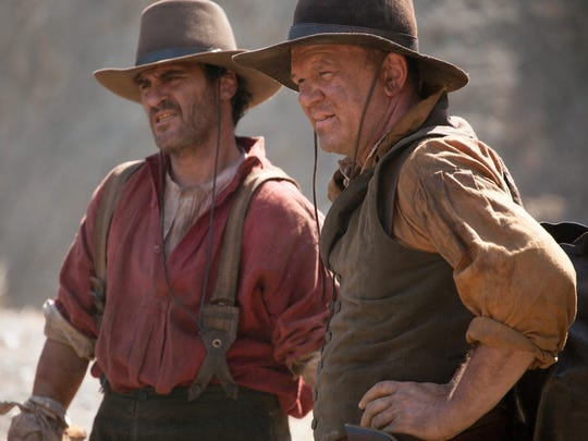 "Joaquin Phoenix (left) and John C. Reilly play siblings in ""The Sisters Brothers."""