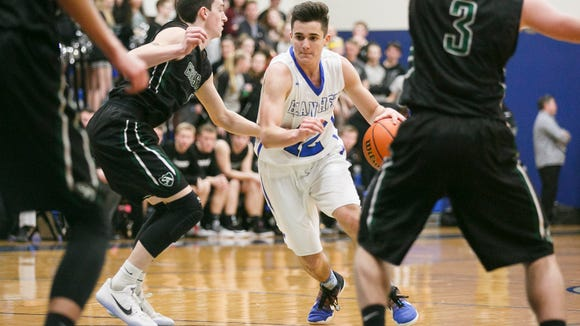 Blanchet's RJ Veliz drives through Salem Academy defense in a game on Tuesday, Jan. 24, 2017, at Blanchet Catholic School. Salem Academy won the matchup 53-42.