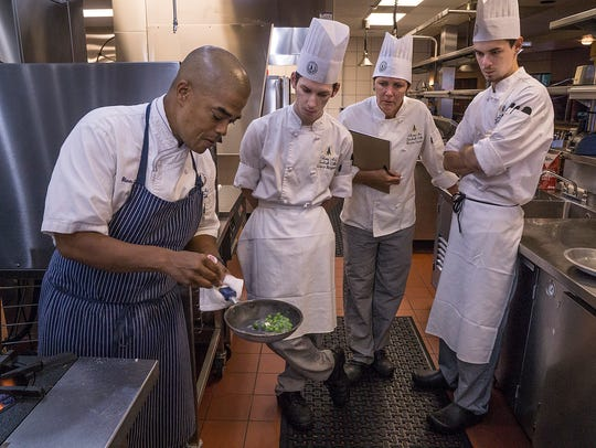 While practicing for the test, Chef Shawn Loving stops