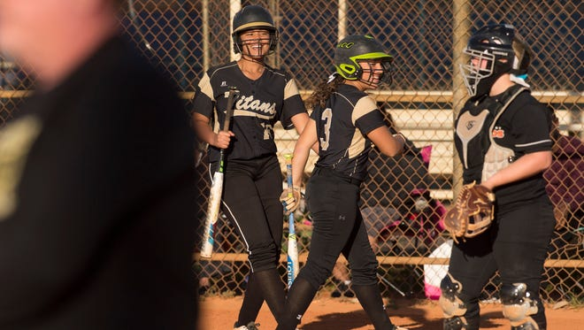 Treasure Coast High School's Brianna Thomas (left) celebrates after scoring a run with teammate Amanda Ruiz in the first inning of their game against Lincoln Park Academy at Lawnwood Park on Wednesday, March 21, 2018, in Fort Pierce. To see more photos, go to TCPalm.com.