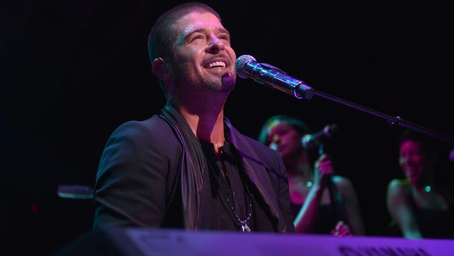 Robin Thicke performs songs from his new album 'Paula' at an album release party on June 26 in West Hollywood, Calif.