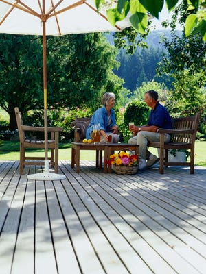 Comfortable seating and protection from the sun are great steps to making your backyard an oasis.