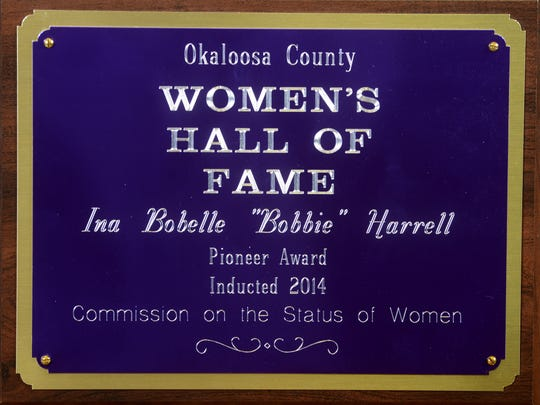 Bobelle W. Harrell posthumously received the Congressional Gold Medal for her service as a pilot in the Civil Air Patrol during WWII. Harrell's daughter, Tracy Harrell Ward, attended the ceremony on behalf of her mother on December 10 in Washington. Harrell was also inducted into the Okaloosa County Women's Hall of Fame as seen in this award.