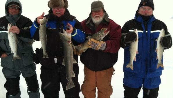 Rod Thompson, of Carlton, MN, Neil Nemmers of Cloquet, MN, John Gantner of Cloquet, MN, Scott Meier of Mahtowa, MN and Bryan Altendorf of Baldwin caught a mixed bag of browns and splake on the ice in January 2015.