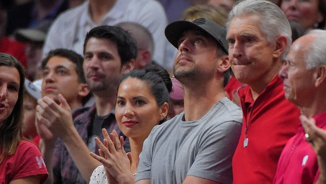 Packers quarterback Aaron Rodgers stands next to actress Olivia Munn as Wisconsin plays North Carolina during the second half of the NCAA tournament regional semifinal on March 26 in Los Angeles.
