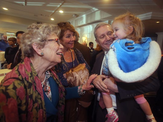 Rockland County District Thomas Zugibe introduces his granddaughter, Abigail Munson, 2, to County Legislator Harriet Cornell and Dr. Mary Jean Marsico, CEO of Rockland BOCES, at an event at the Nyack Seaport Jan. 25, 2018 where Zugibe announced that he is running for state Supreme Court justice in the upcoming November elections.