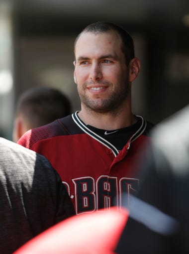 Arizona Diamondbacks first baseman Paul Goldschmidt jokes with teammates in the dugout in the first inning of a baseball game against the Colorado Rockies, Sunday, June 10, 2018, in Denver. (AP Photo/David Zalubowski)