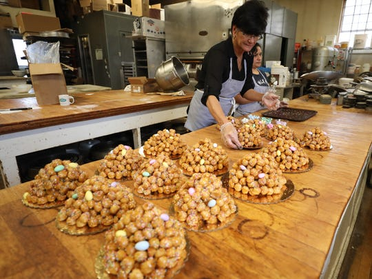 Emily Paonessa, arranges the completed struffoli on