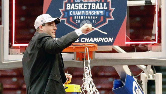 Mar 14, 2015; Birmingham, AL, USA; UAB Blazers head coach Jerod Haase cuts the net down after his team won the Conference USA Tournament Championship against the Middle Tennessee Blue Raiders at Jefferson Convention Complex. The Blazers defeated the Blue Raiders 73-60. Mandatory Credit: Marvin Gentry-USA TODAY Sports .