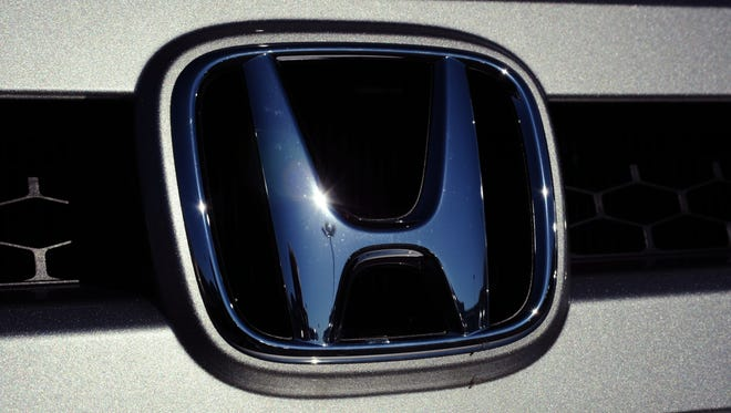 Honda Motors logo is seen in the grill of a vehicle at a dealership in Manassas, Va.