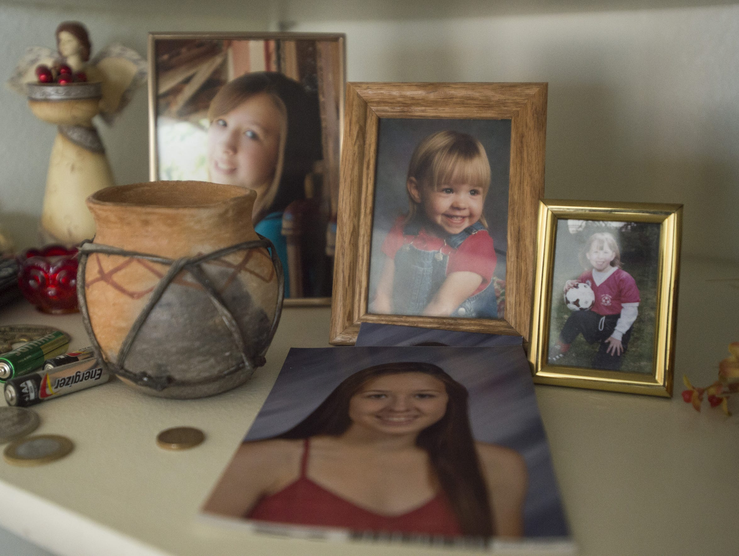 Pictures of grandchildren and family member line the