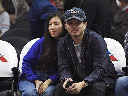 Actor Steven Yeun, right, married longtime girlfriend