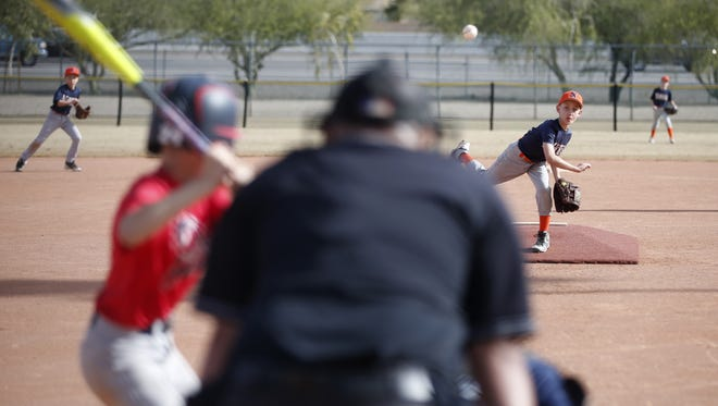 Peoria Naturals pitcher Connor Fischer, 11, throws during a game at Rio Vista Community Park in Peoria on Jan. 16, 2016. Peoria is moving forward on plans to open a new community park in the northern part of the city off Lake Pleasant Parkway near West Wing Mountain that will have many of the same amenities as its Rio Vista and Pioneer community parks.