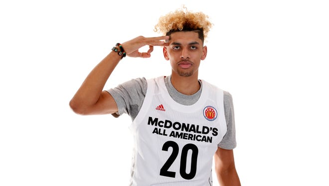 """Mar 26, 2017; Chicago, IL, USA; McDonalds High School All-American forward Brian """"Tugs"""" Bowen II (20) poses for a photo during the 2017 McDonalds All American Game Portrait Day at Chicago Marriott. Mandatory Credit: Brian Spurlock-USA TODAY Sports"""
