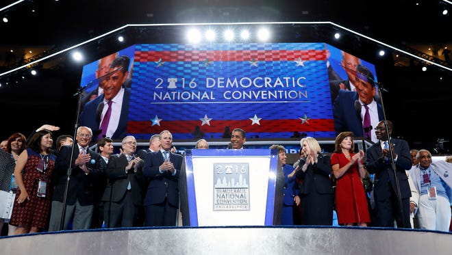 New York State Senator Adriano Espaillat is joined on state by New York legislators during the first day of the Democratic National Convention in Philadelphia , Monday, July 25, 2016.