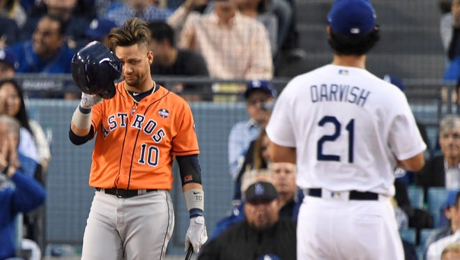 Yuli Gurriel tips his helmet toward Yu Darvish before batting in Game 7 of the World Series.