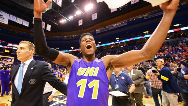 Northern Iowa Panthers guard Wes Washpun (11) celebrates after hitting the game winning shot at the buzzer to defeat the Evansville Aces in the championship game of the Missouri Valley Conference tournament at Scottrade Center. Northern Iowa defeated Evansville 56-54.