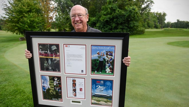 Ron Sanders holds a display of recognition he received for his role in bringing the PGA Tour Champions event to Minnesota during an interview Wednesday, Aug. 2, in Sartell.