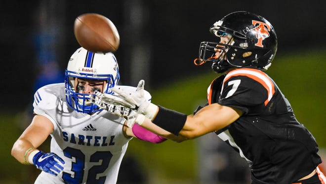 Tech's Luka Rajkic tries to intercept a pass in front of Sartell's Ryan Giguere during the first half of the Friday, Sept. 22, game at Husky Stadium in St. Cloud.