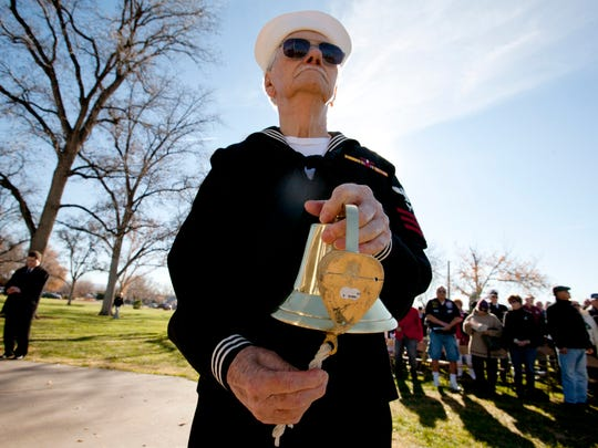 "Pearl Harbor survivor Carl Allen rings a ship's bell as the names of his fellow survivors of the Dec. 7, 1941 Japanese attack who passed away this year are read during a ceremony marking the 69th anniversary of the ""Day of Infamy"" Tuesday, Dec. 7, 2010 at Vernon Worthen Park in St. George."