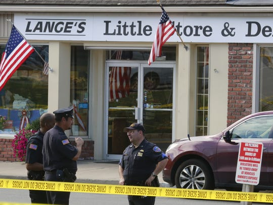 New Castle police investigate the scene of a shooting at Lange's Little Store & Delicatessen in Chappaqua that injured two victims on Aug. 29, 2016.  The alleged  shooter, Hengjun Chao, 49, of Tuckahoe, was arrested at the scene.