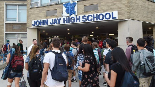 Students make their way inside John Jay High School for the first day of school on Sept. 6.