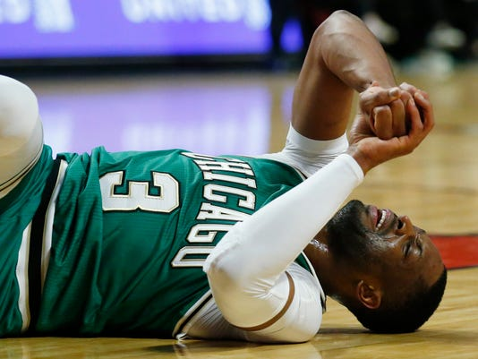 Chicago Bulls guard Dwyane Wade reacts after being injured during the second half of an NBA basketball game against the Memphis Grizzlies Wednesday, March 15, 2017, in Chicago. The Grizzlies won 98-91. (AP Photo/Nam Y. Huh)