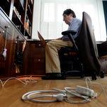 Vanderbilt University Chancellor Nicholas S. Zeppos works on his laptop in his home office April 8, 2016, in Nashville.