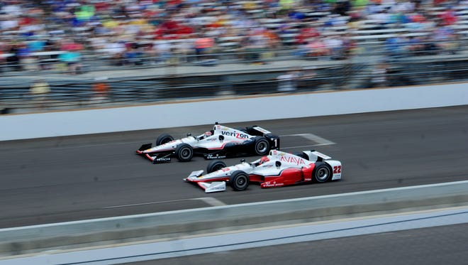 IndyCar Series driver Will Power (1) races Simon Pagenaud (22).
