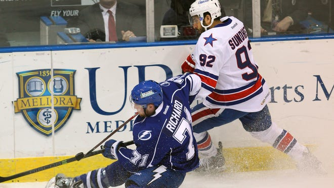 Syracuse's Tanner Richard (71) loses the puck when pressured from behind by Rochester's Kevin Sundher (92) in this 2013 file photo.