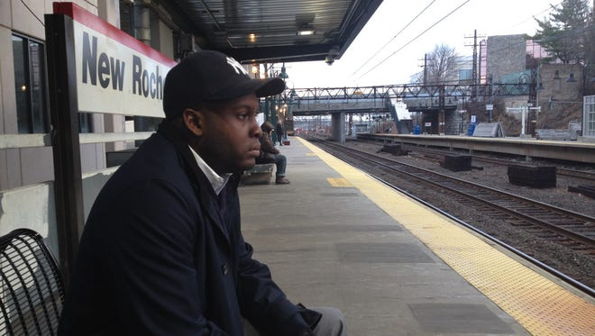 Commuter Andrew Joseph, 32, waits Dec. 24, 2013, for a Metro-North Railroad train to take him from New Rochelle, N.Y., to Manhattan. The federal deduction for transit drops to $130 a month Jan. 1.
