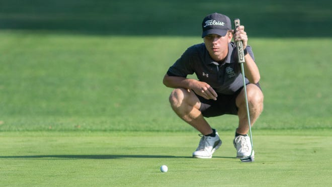 Central Catholic's Kyle Freudeman, seen here eyeing a putt during the boys Division III district golf tournament at Tannenhauf Golf Club last year, won Thursday's NOPGA Junior Series event at Windmill Lakes.