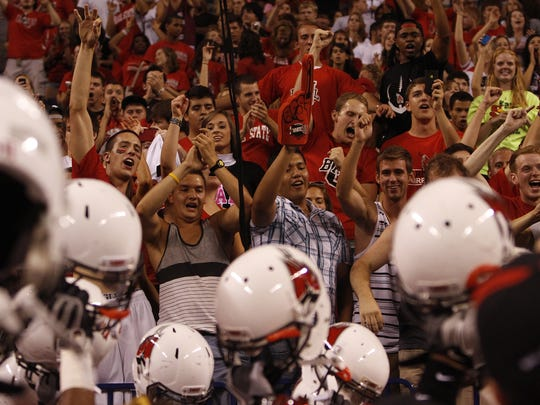 FILE -- Ball State fans cheer as Ball State football players greet them in the stands after defeating Indiana at Lucas Oil Stadium in Indianapolis on Sept. 3, 2011.