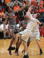 Mansfield Senior's Robert Stewart swats the ball from Clear Fork's Brady Tedrow during Friday's Division II sectional championship game at Bucyrus High School.