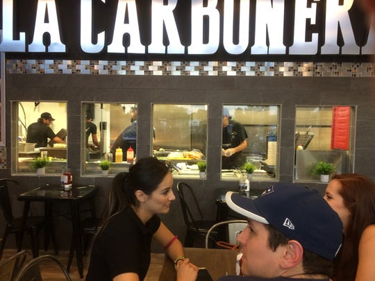A busy evening at the La Carbonera Charcoal Grilled