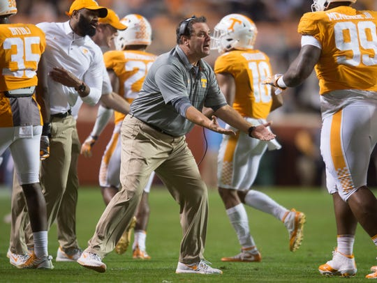 Tennessee Interim Head Coach Brady Hoke congratulates