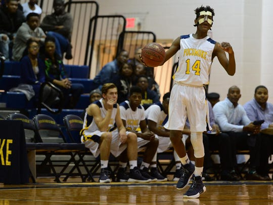 D'Aron James brings the ball down the court against