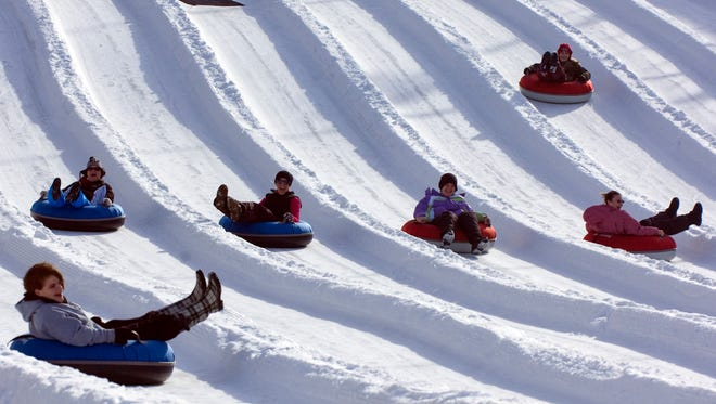 People ride inflatable tubes down a run at Ober Gatlinburg on Jan. 16, 2011.